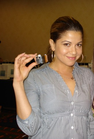 Luciana Carro at the July 2009 Hollywood Show in Burbank, CA, checking out jewellery by Not Just Any Old Day